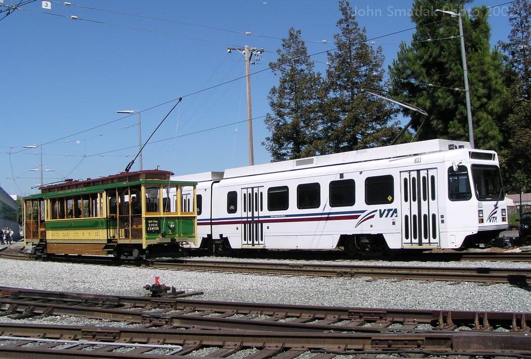 Photo of side-by-side old and new trolley cars